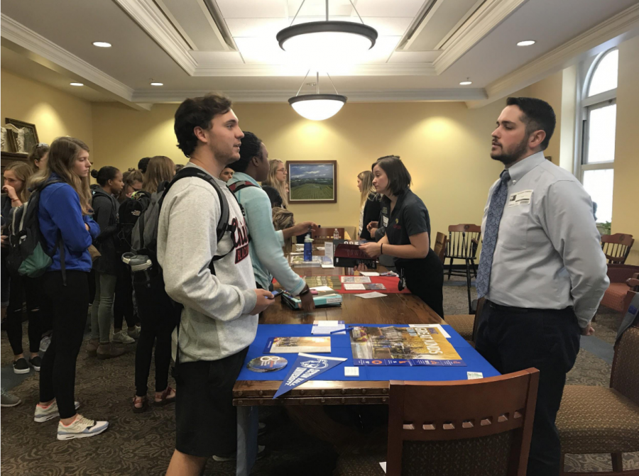 Carson Corley, '20, speaks with Seton Hall University representative Alejandro Ramirez. The counseling department encourages juniors and SENIORS to utilize college fairs and ask questions.
