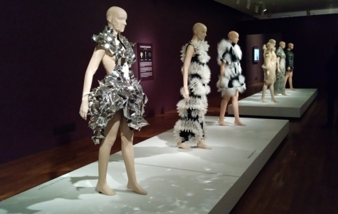 A row of mannequins display dynamic dresses from Iris Van Herpen's Crystallization collection at the Cincinnati Art Museum. Van Herpen combines everyday, unconventional materials and advanced technology to create innovative fashion pieces.