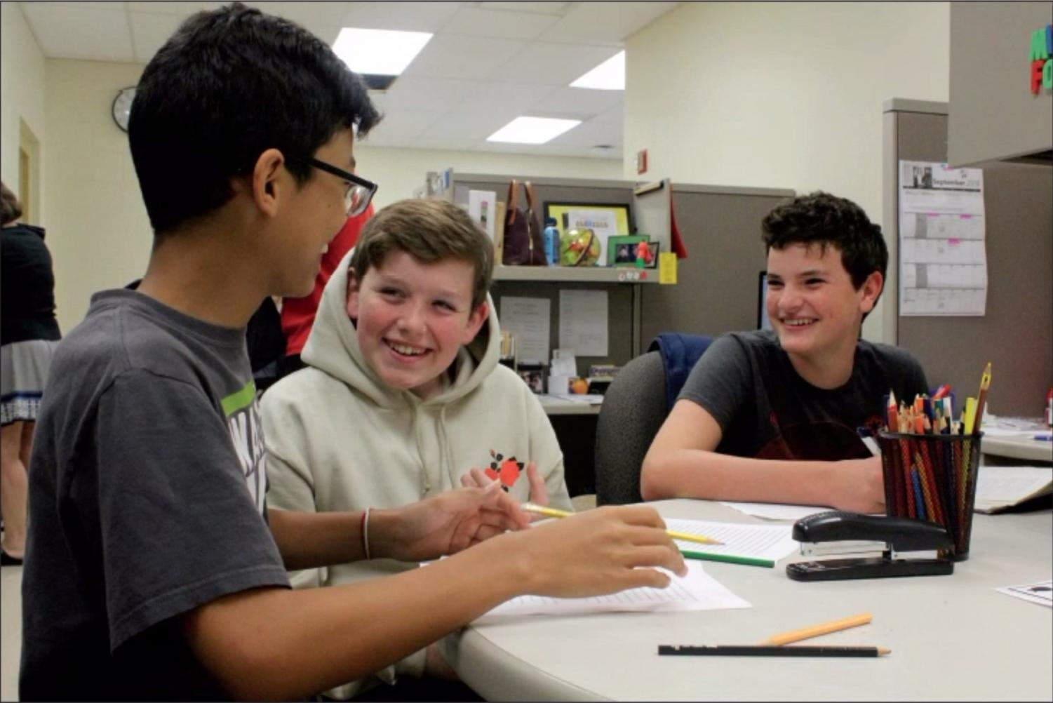 """Eric Ravenscraft, Kevin """"K.P."""" Phelps and Hadrian Dwyer, '23, collaborate on their homework at the Student Success Center (S.S.C.). The S.S.C. is a place where all students are welcome to ask questions and receive help, whether regarding schoolwork, extracurriculars or their future at Walnut."""