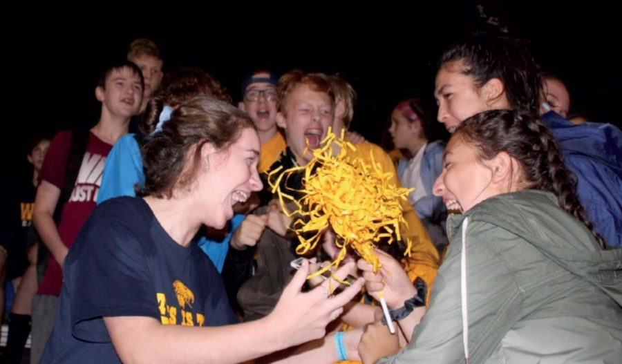 Some WHHS students show their school spirit by attending football games and cheering on the Eagles. WHHS played St. Xavier in a rainy competition, but students' spirits were not dampened.