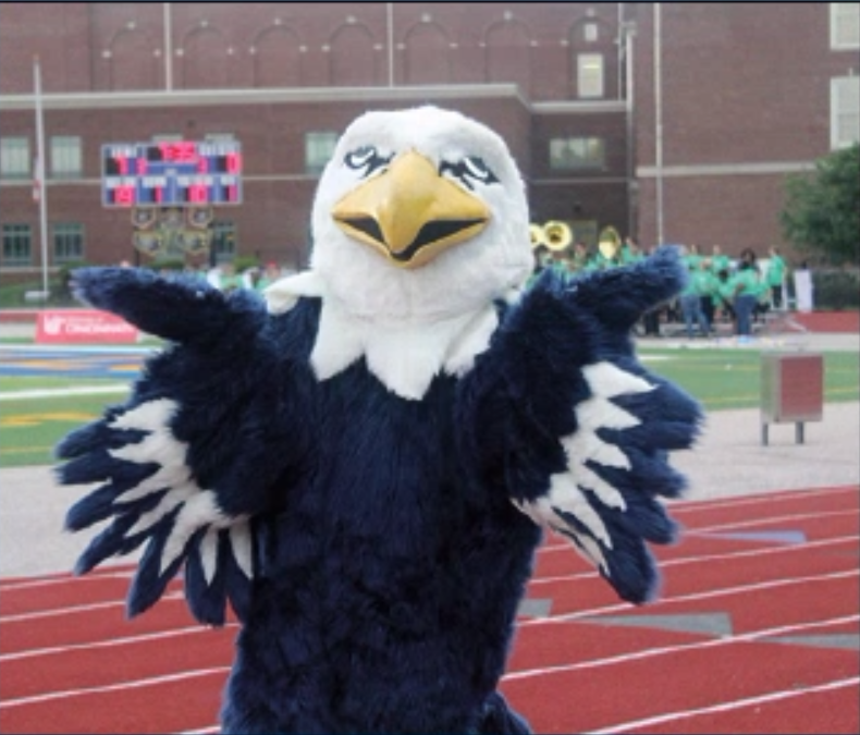The+Eagle+mascot+stands+on+the+track+before+the+game+starts.