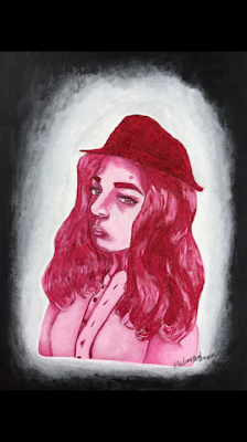 Madison Hochman, '18, painted a self portrait that contrasts with the white and black background. Hochman said that she began to take art more seriously in eighth grade.