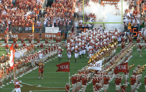 Texas Longhorns make their entrance onto the field on opening day. As the college championship season came to a close, the dynamic of the teams drastically changed.