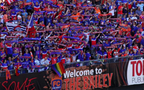 Orchestra teacher Chris Gibson (center, front row) celebrates with other FC Cincinnati Fans in the Bailey at the University of Cincinnati. FCC has revitalized the soccer fandom in the city, and brings nearly 30,000 fans to each game.