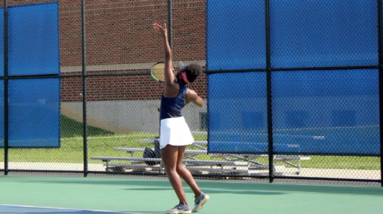 SENIOR+Jalyn+Hall+looks+to+take+a+serve+in+a+match+against+Kings+High+School.+Hall+is+currently+battling+tendonitis+while+trying+to+make+it+through+her+season.