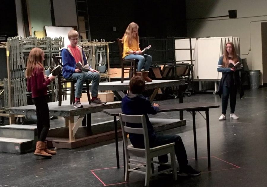 From left to right: Sophie Christian '23, Gabe Conley '23, Nate Caudill '24, Isabella Lachey '24 and Avery Frank '23. While the crew has set up a makeshift set in the auditiorium, the courtroom setup is evident here, and will be translated into the final production.