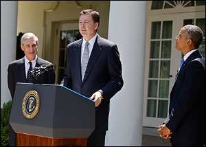 FBI Director James Comey with President Obama in 2013. Comey gave testimony to a Senate hearing Wednesday, though many of the Senate's questions could not be answered due to classified information.
