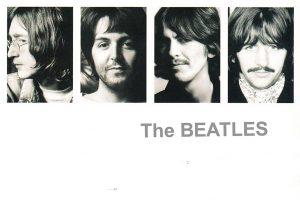The cover of a 2009 re-release of 1968's The Beatles. The original album cover did not feature the faces of the band, rather only their name, lending it being called the White Album.