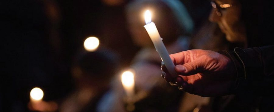 A mourner holds a candle at the vigil for the Pittsburgh synagogue shooting held by Governor Tom Wolf. Advocates against anti-Semitism are hoping to take this tragedy and turn it into an opportunity to raise awareness around anti-Semitism today and in the future of the United States.