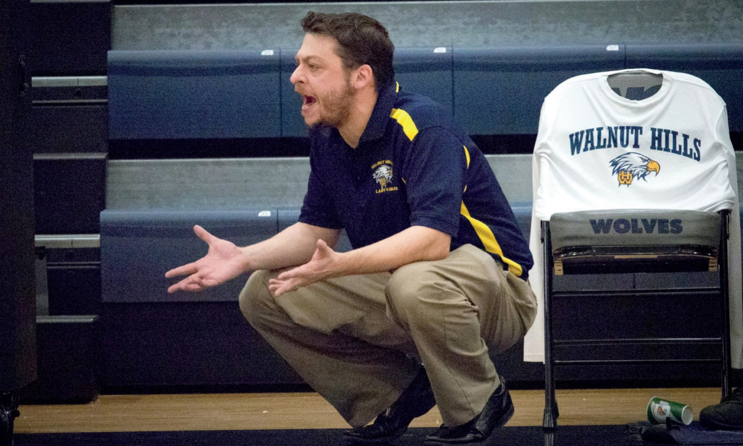 Coach Adam Lazar shows his dismay after a questionable call from the official. After a close game with the West Clermont Wolves, the WHHS Lady Eagles won 49-41.