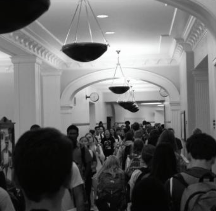 Hundreds of students walk through the main hallway between classes, creating congestion that can be felt throughout the building.