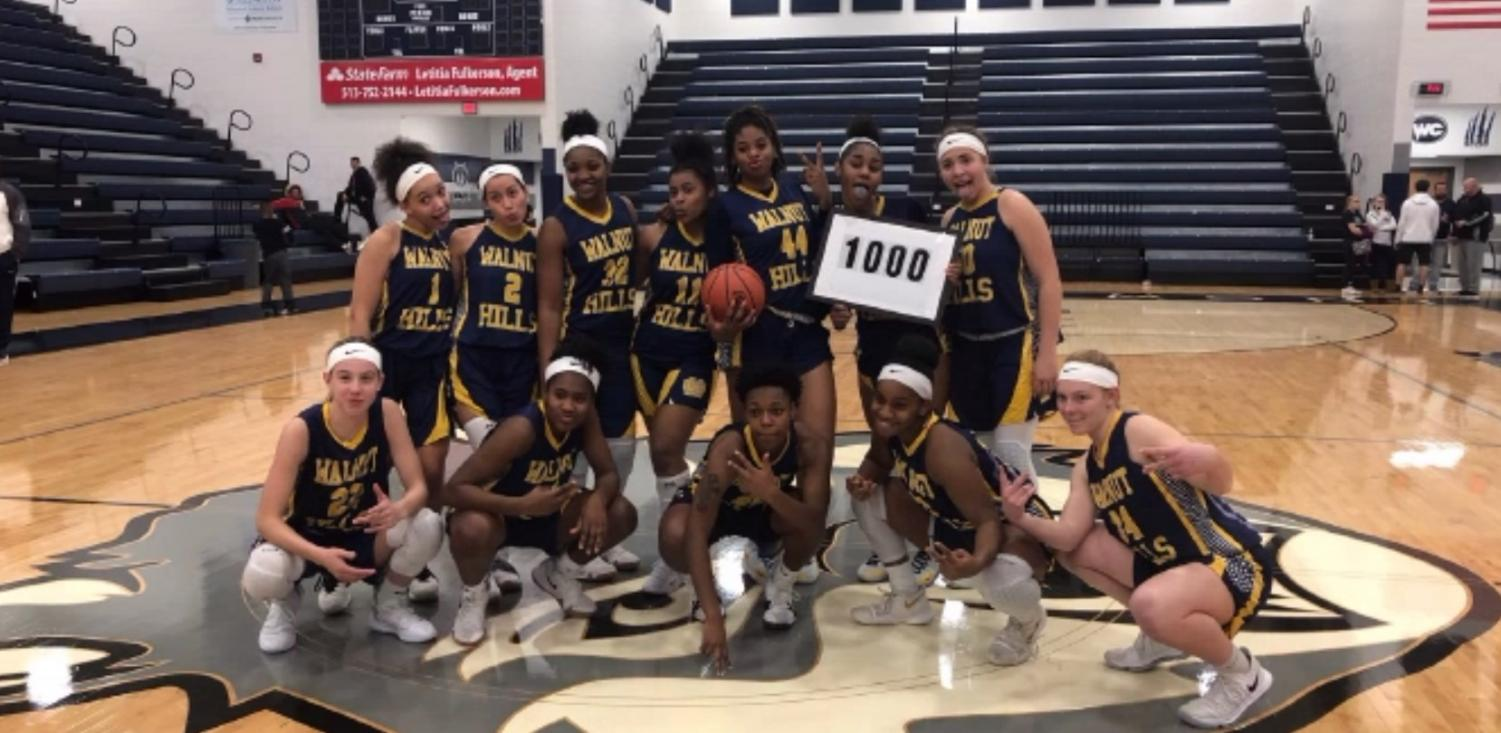 The Women's Varsity Basketball Team gathers to celebrate teammate Kennedi Myles's 1,000th point. The Lady Eagles triumphed over West Clermont in an Eastern Cincinnati Conference matchup on Dec. 3.
