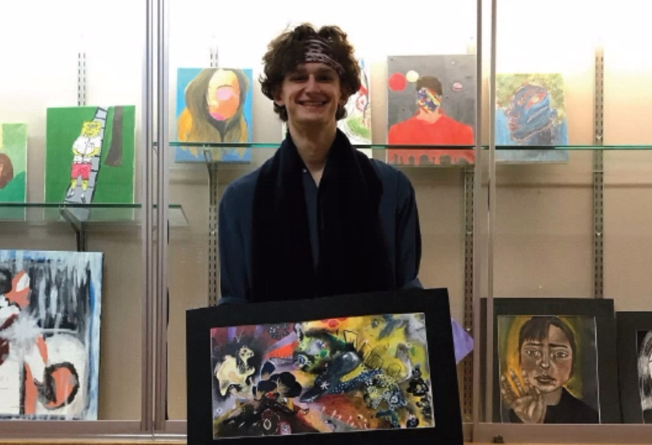 SENIOR Arthur Schmid stands above with one of his award-winning pieces from the Scholastic Art Awards. The Awards are being shown in the Art Academy of Cincinnati through Feb. 8.