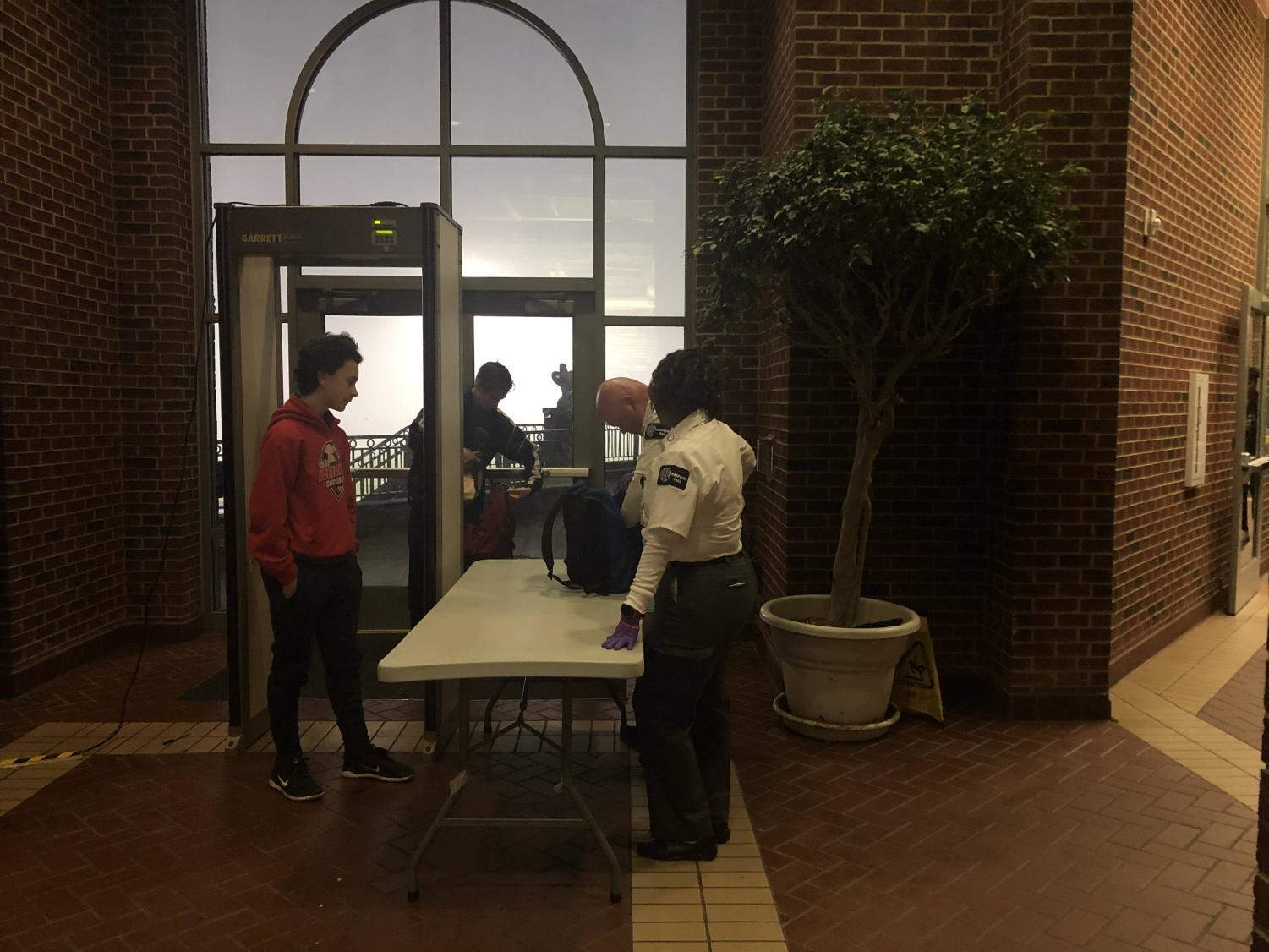 Every morning, students must clear metal detectors and have their bags searched when entering the school. Metal detectors are part of a new security protocol added this school year.