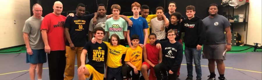 The WHHS Junior High, Junior Varsity and Varsity Wrestling teams pose together after practice. The teams now have a total of over 20 members, a much improved number from last season's two members.