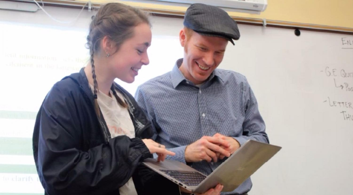 AP Literature and Composition teacher Jake Riordan helps SENIOR Isabelle Brandicourt (right) and Louis Martini, '20 (left), with ideas for a project. Riordan worked closely with his students during second quarter as they completed a comprehensive poetry study, including guiding them as they wrote poems in the style of a living poet and then sent their poem to the poet.