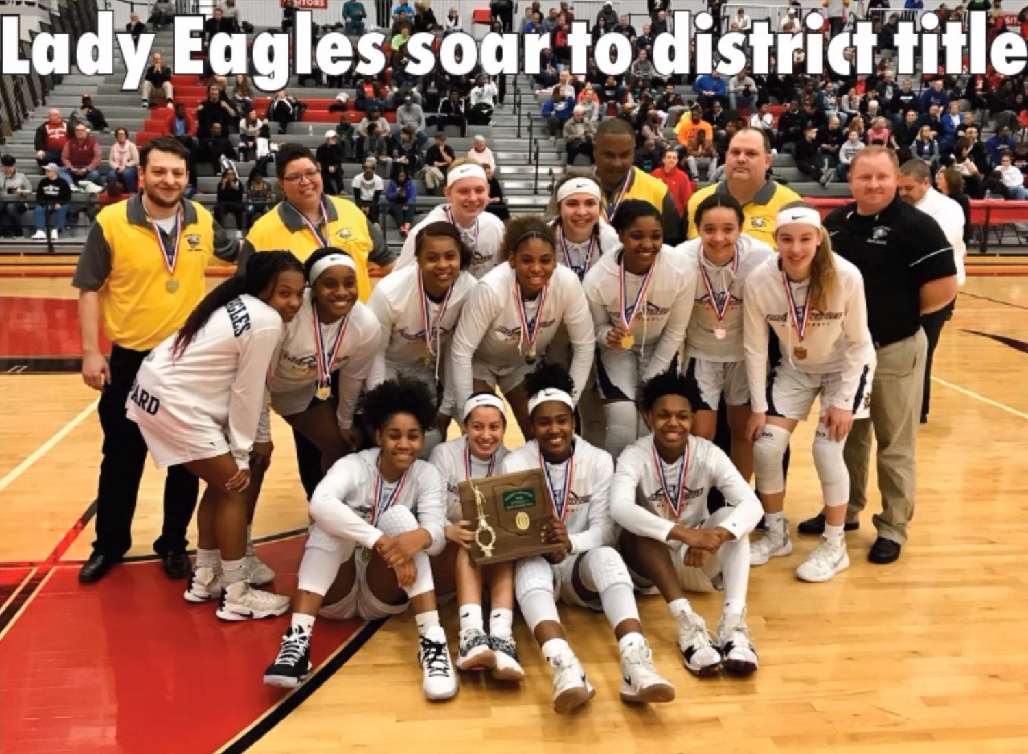 The Lady Eagles celebrate as a team as they show off their recently awarded OHSAA District champion trophy and medals. After beating Huber Heights Wayne to win this title at the district level, they advanced to play Centerville High School in the regional semifinals, where they lost 54-39 in a hard-fought effort.