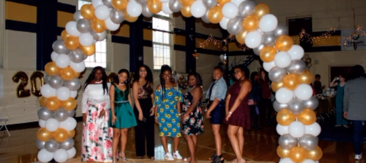 Junior high students pose for a picture at the annual Twilight Ball dance. Colorful decorations adorned the Junior High Gym around them as their classmates danced and enjoyed the night.
