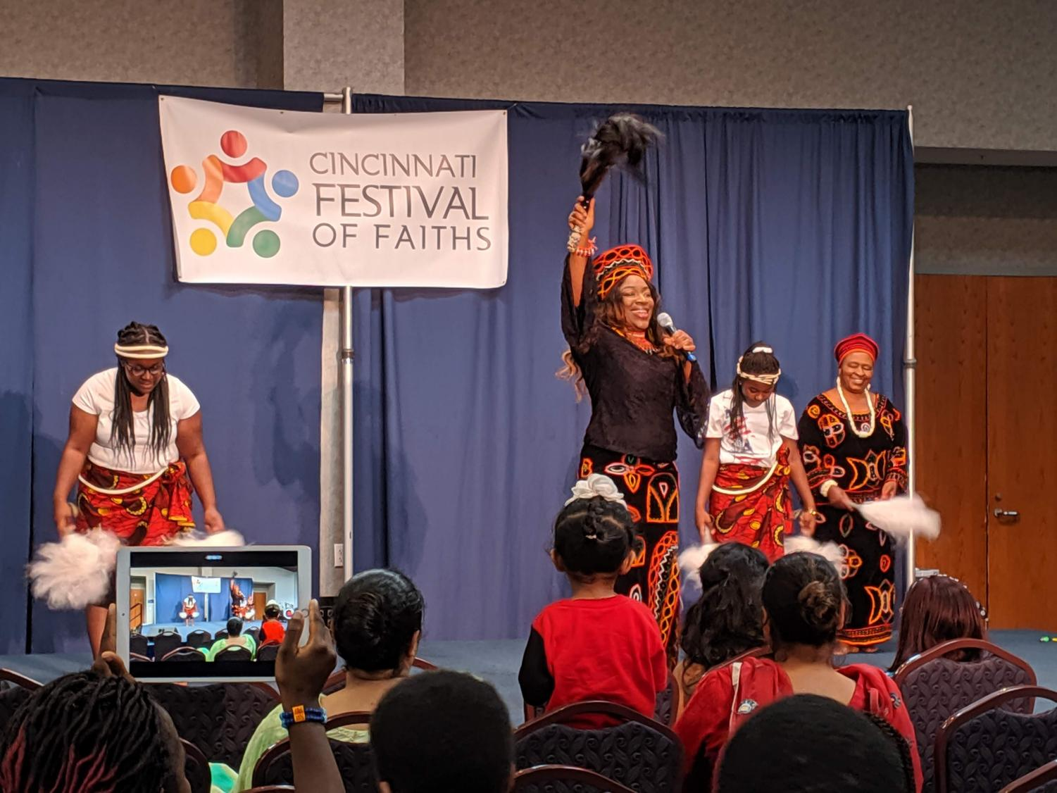 A quartet of dancers perform Cameroonian song and dance in traditional costume. A variety of performances occurred throughout the festival, demonstrating an impressive array of faiths and cultures.