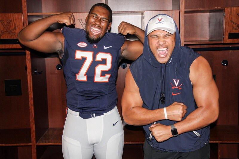Jowon Briggs, '19, with D-Line coach Vic So'oto after committing to Virginia.