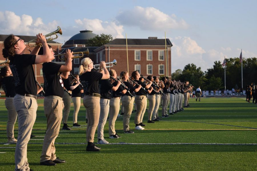 The+WHHS+Marching+Blue+and+Gold+practice+for+their+competition+at+Ohio+State+University.+Their+next+performance+will+be+at+the+Homecoming+game+on+Friday%2C+Oct.+4.