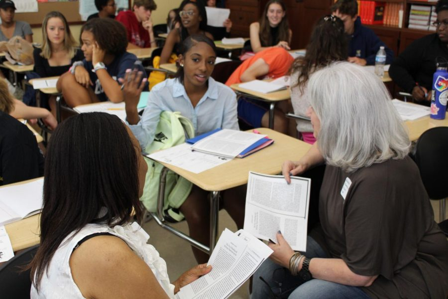 Alumni Randie Flaig and Brenda Pinkelton, '69, discuss a passage in AP Language & Composition - Human Rights with Nadiah Johnson, '21. The three of them also traded stories from their high school careers at WHHS.