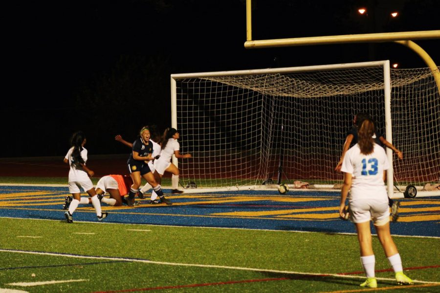 SENIOR Bailey Brant celebrates after she scored against Winton Woods in the girls varsity soccer SENIOR night game. The WHHS Eagles dominated the Warriors 9-1.