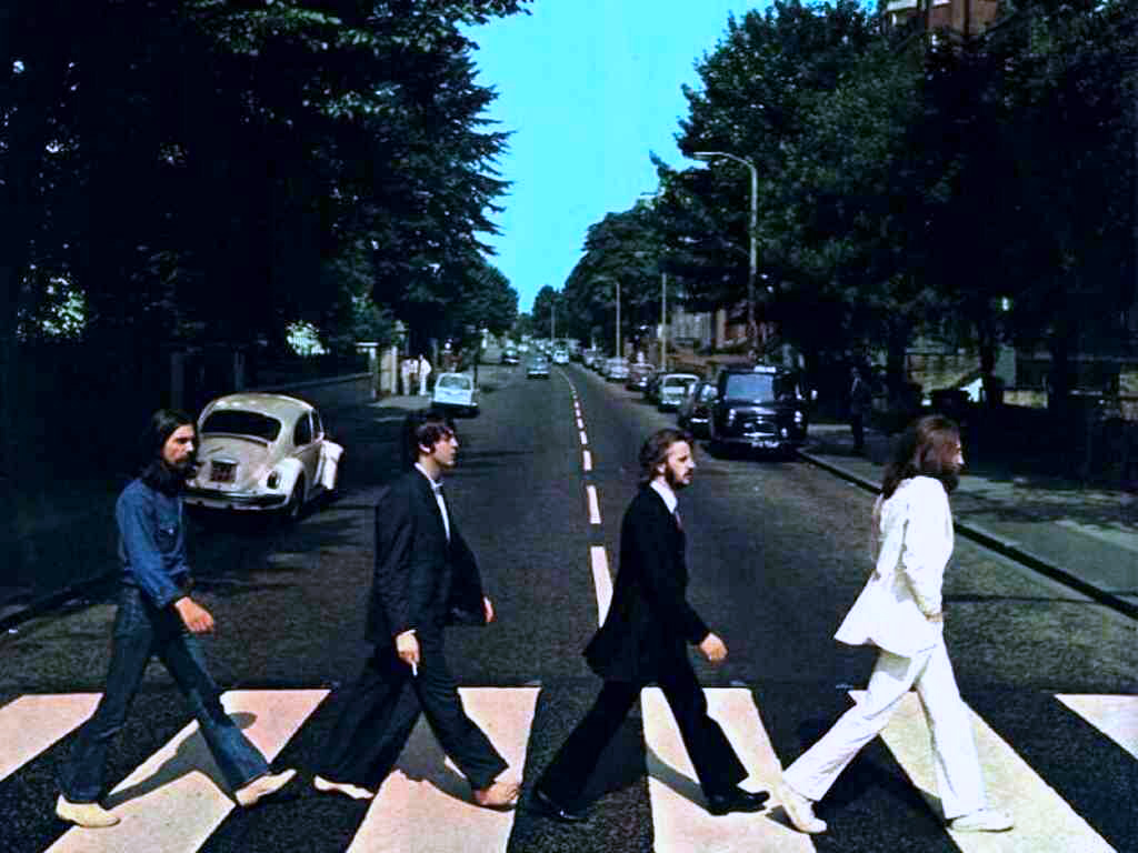 The iconic album cover for the Beatles' Abbey Road features band members John Lennon, Paul McCartney, George Harrison and Ringo Starr. Abbey Road was first released in 1969.
