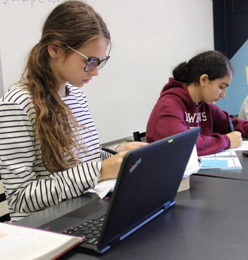 Alexis Miller, '24, works on her Latin homework while Shahd Mashali, '24, studies her vocab words in the Student Success Center, a place for students to improve their studying skills.