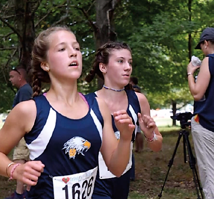 Mary Westrich '22 and Katie Stiens '23, determined to win, race to the finish line of the varsity race at the Trinity-Valkyrie meet in Louisville, Kentucky.