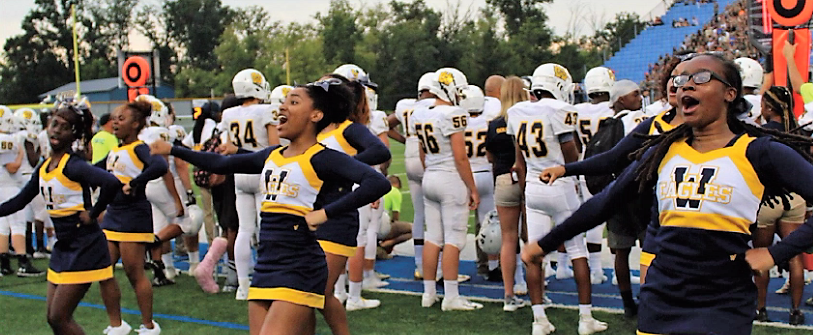 Janasia Wilkerson '21, Adonya Streat '21, and Zkiyah Tafari-thompson '22 cheer on our WHHS Eagles varsity football team at Miamisburg High School. The cheer team is is ready for redemption after finishing second in the ECC competition.