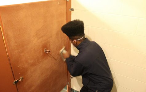 WHHS art club beautifies school with bathroom stall decoration