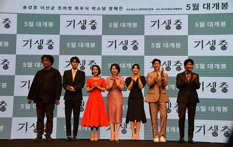 Director Bong Joon-Ho applauds with the cast of 'Parasite' at an April 2019 press event. Writer, SENIOR Matthew Proietti, ranked 'Parasite' as one of the best movies of 2019.