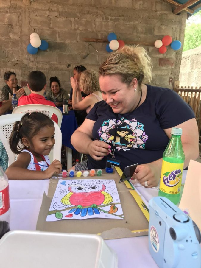 Art+teacher+Liz+Llyod+%28right%29+and+Emely+%28left%29%2C+the+Nicaraguan+child+she+sponsors%2C+paint+an+owl+together.+Lloyd%E2%80%99s+yearly+donations+allow+Emely+to+attend+school.