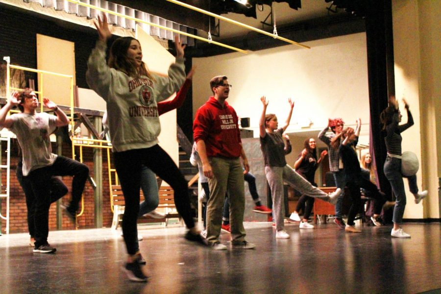 "The ensemble of 'Urinetown' practices choreography during rehearsal. The show's ensemble, divided into the ""Rich"" and the ""Poor,"" plays a heavy role in the production, serving as additional actors, singers, and dancers."