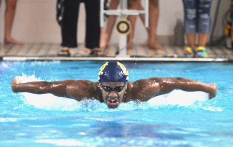"""Barry Bates, '21, swims butterfly at a meet at WHHS. Bates honed the skill at practice. """"Swimming really depends on how much the swimmer wants to get out of practices ... but all comes together with the team in the end too,"""" Sakura Adachi, '23, said."""