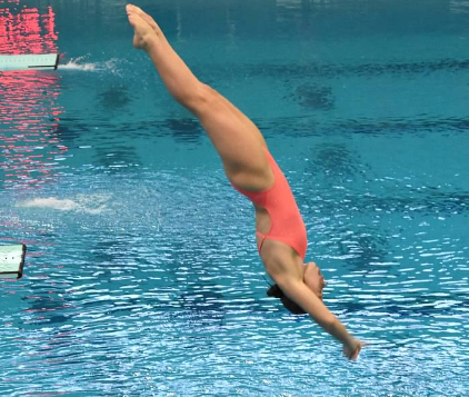 Bela Noble, '22, practices diving at the University of Cincinnati Campus Recreation Center. At meets she enjoys how