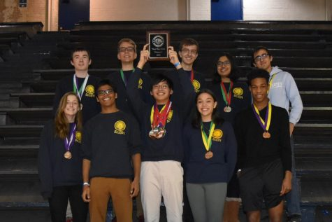 Members of the WHHS Science Olympiad team pose with their commemorative plaque for ranking third in the regional competition. Medals were also awarded to students for placing in the top six of individual events.