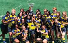 The WHHS women's rugby team poses with their trophy after defeating St. Joseph Academy from Cleveland.
