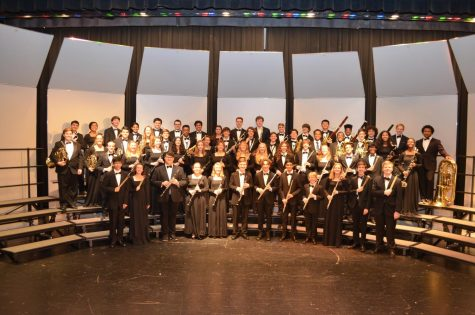 The 2018-2019 WHHS Wind Ensemble pose on the stage where they performed several concerts. The Wind Ensemble was included in the senior high band concert on Feb. 25, 2020.