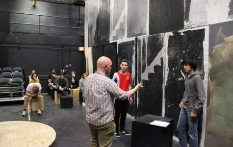 """Theatre department chair, Michael Sherman, advises students during a rehearsal for the fall production of 'The Curious Incident of the Dog in the Night-Time.' This spring, Sherman had to cancel the junior high musical, 'Hairspray Jr.,' due to COVID-19. """"It's the first time I've ever had to do it in my 12 years teaching theater, but, you know, these are extraordinary circumstances,"""" Sherman said."""