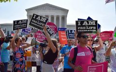 Both pro-life and pro-choice protestors gather outside the Supreme Court in 2016. The demonstration protested the landmark decision of Whole Woman's Health vs Hellerstedt. The Court ruled that Texas could not put restricitons on abortion services to prevent women from seeking an abortion.