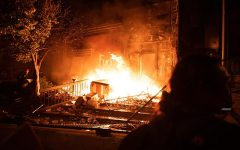 Following the murder of George Floyd, rioters start a fire outside of the Minneapolis Police Department's 3rd Precinct. This precinct was the one where Derek Chauvin, the man who killed Floyd, worked.