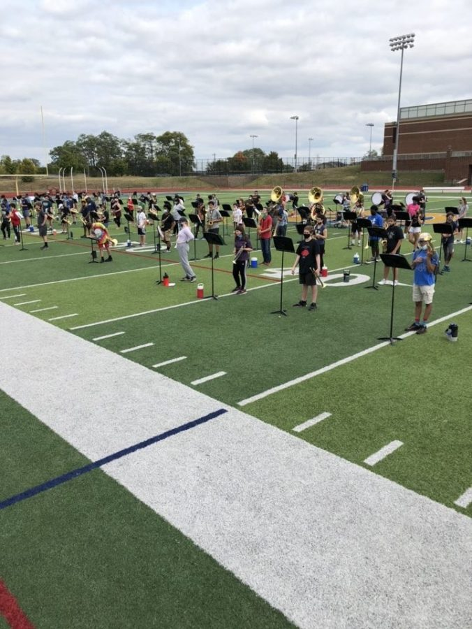 "WHHS marching band students practicing while social distancing. This performance is based on a dragon with the band performing ""This is Berk"" from How to Train your Dragon and ""Believer"" by Imagine Dragons."