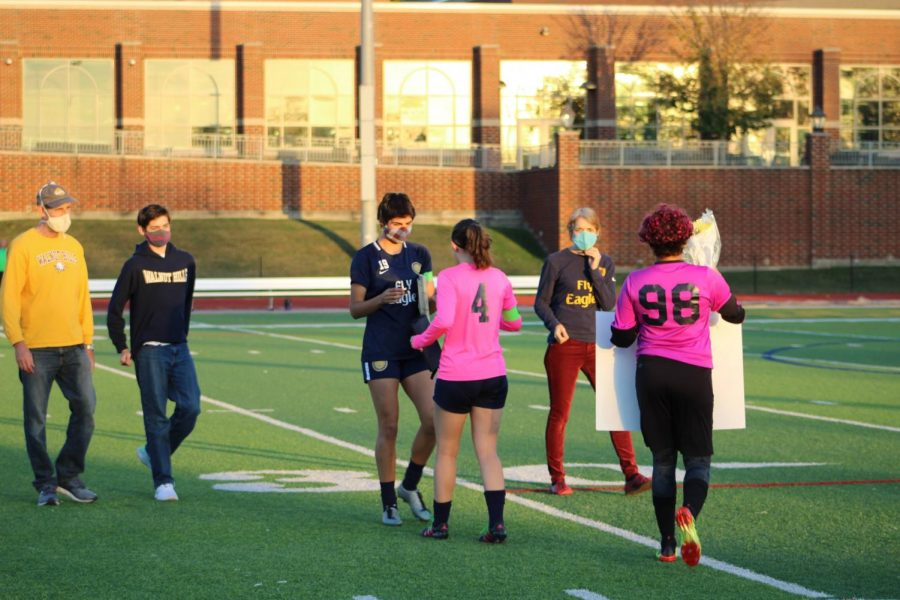 While standing on the field at senior night, Tamar Sella is cheered on by friends and family for her hard work and dedication over the past four years.
