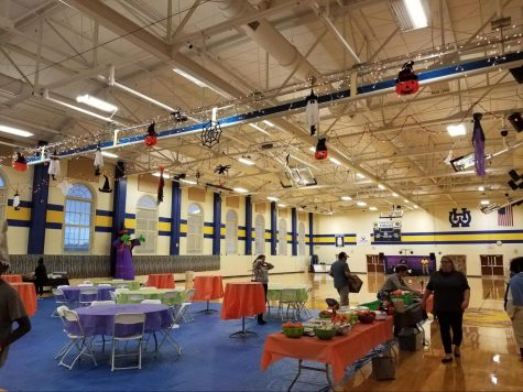 Volunteers set up last year's boogie bash in the WHHS Gymnasium. The Boogie Bash has been a way for seventh and eighth graders to get creative and celebrate Halloween with their fellow classmates. This year, due to COVID-19, the Boogie Bash has been moved online.