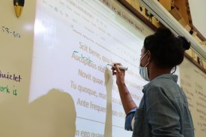 Students in Laura Brogden's 8th bell, AP IV Latin practice translations on the board. This year her Latin 3 classes are reading the Hercules stories. She plans on incorporating stories about people in the ancient world that aren't typically found in textbooks.