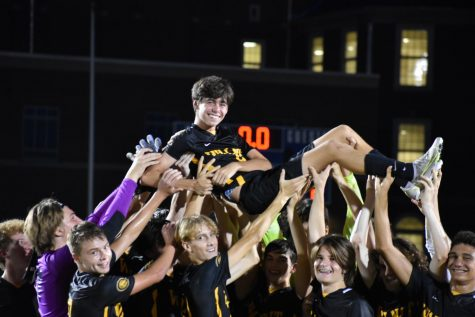 Sophmore Roman Girandola being lifted up by his teammates in celebration of a win