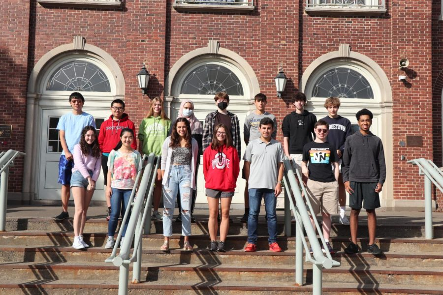 17 National Merrit Finalists pose in front of WHHS