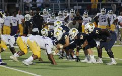 The WHHS defensive line stands countering the Aiken offensive line, waiting for the ball to be snapped during the game on Aug. 20.